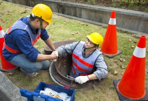Two Sewerage Workers In The Manhole | Drain Ratz Plumbers